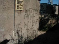 Graffiti on the walls surrounding Kawther's home