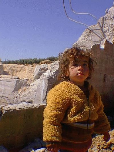 1.5 year old Wa'ad Al-Atrash in front of her newly demolished home (not related to this case)