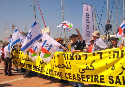 The peace activists demonstrate on the shore