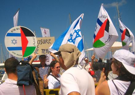 Israeli and Gush Shalom flags at the protest