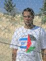 Bassem wearing the Gush shalom shirt with the flags of Israel and Palestine