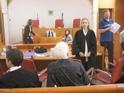 Advocate Gaby Lasky (standing) in the courtroom at the start of  the proceedings
